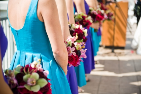 The violet and aqua bridesmaids dresses just popped.  10 bridesmaids!