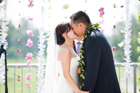 I LOVE this image of Sharon and Dean kissing beneath a shower of orchids and white paper cranes (hand-folded by Angel herself!)