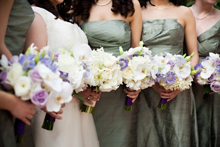 The bridesmaids carried fluffy hydrangea, phaleonopsis orchids, lavender scabiosa, and more.