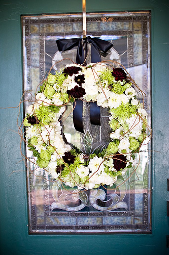 A simple wreath hung on the door of the front porch.