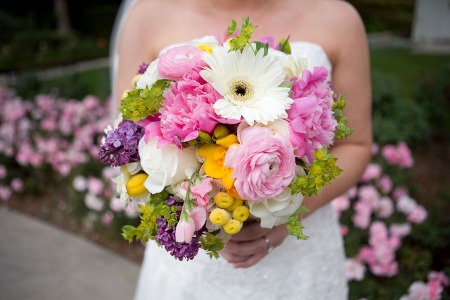 Playful and pretty.  Peonies, gerberas, mini button mums, roses, viburnum, ranuncula, sweet peas.