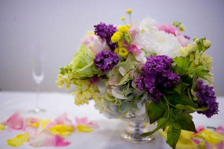 Sweet little arrangements of hydrangea, lilacs, and other treasures of spring overflowing from silver urns.